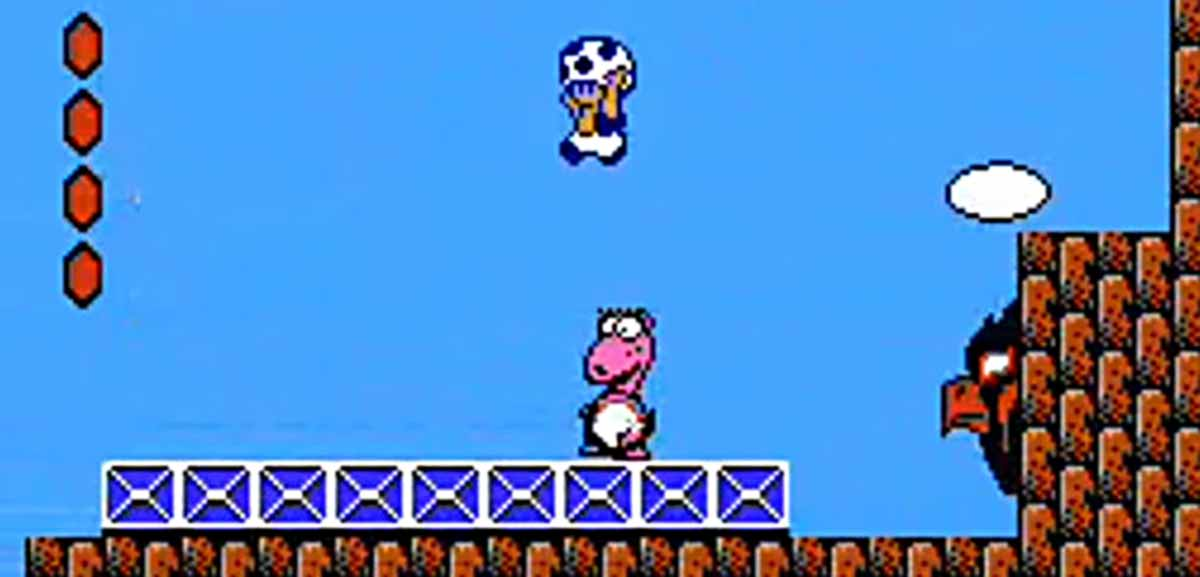 Screen capture of Super Mario Bros. 2, with Toady character leaping over a miniboss named Birdo