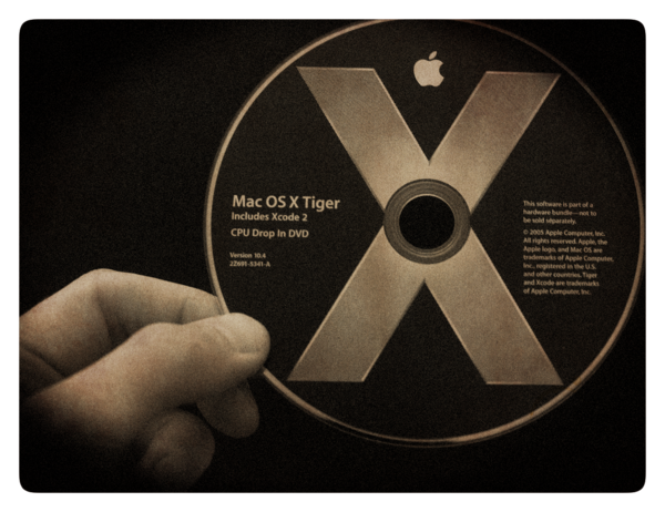 image of hand holding Mac OS X Tiger DVD